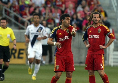 Kim Raff  |  The Salt Lake Tribune (left) Real Salt Lake midfielder Javier Morales (11) talks to (right) Real Salt Lake midfielder Kyle Beckerman (5) and other teammates after a second goal was scored by the Los Angeles Galaxy in the first 13 minutes of the game at Rio Tinto in Sandy on April 27, 2013. Real Salt Lake lost the game 2-0.