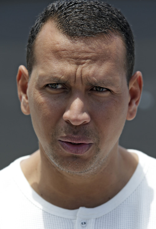 New York Yankees third baseman Alex Rodriguez talks to reporters after arriving at the Yankees Minor League complex Monday, May 6, 2013 in Tampa, Fla., (AP Photo/Chris O'Meara)