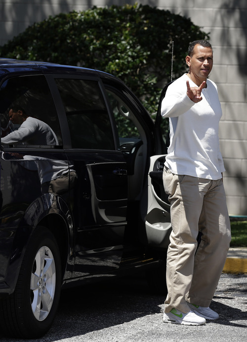 New York Yankees third baseman Alex Rodriguez gestures as he arrives at the Yankees' Minor League complex for rehabilitation Monday, May 6, 2013, in Tampa, Fla. Rodriguez is rehabbing from hip surgery. (AP Photo/Chris O'Meara)
