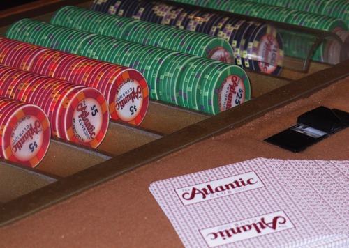 In this April 16, 2013 photo, casino chips and cards await use on a table at The Atlantic Club Casino Hotel in Atlantic City, N.J. The nation's commercial casinos saw their gambling revenue increase by nearly 5 percent last year, making up most of the ground they lost since 2007 when the Great Recession hit. (AP Photo/Wayne Parry)