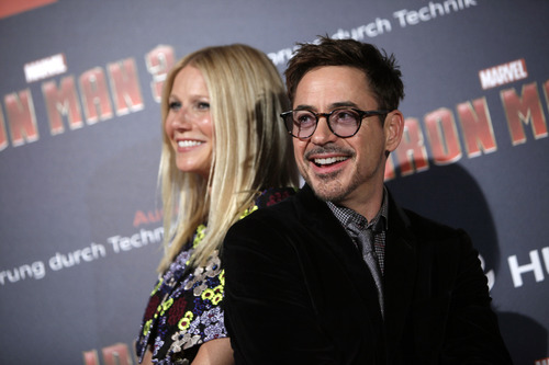 U.S actors Robert Downey Jr., right and Gwyneth Paltrow pose for photographers during the Iron Man 3 premiere, in Paris, Sunday April 14, 2013. (AP Photo/Thibault Camus)