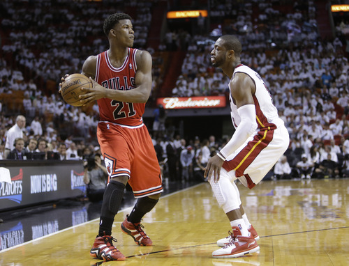 Chicago Bulls forward Jimmy Butler looks for an opening past Miami Heat guard Dwyane Wade, right, during the second half of Game 1 of the NBA basketball playoff series in the Eastern Conference semifinals, Monday, May 6, 2013 in Miami. (AP Photo/Lynne Sladky)