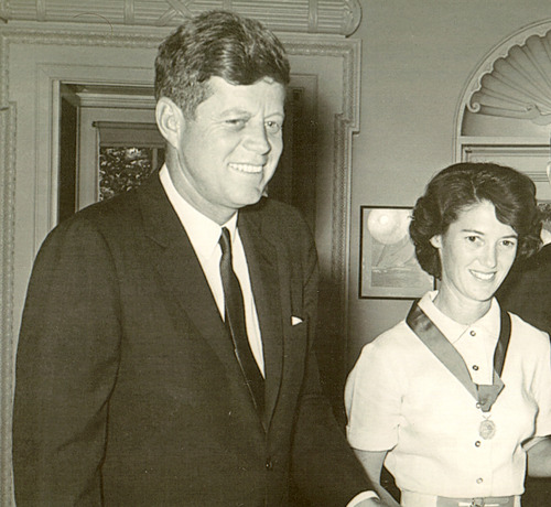 Courtesy image President John F. Kennedy honors pilot Betty Miller for her solo flight across the Pacific.