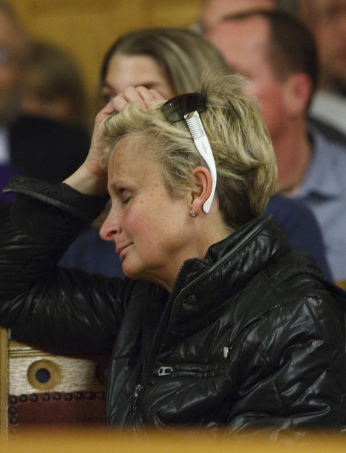 Leah Hogsten     The Salt Lake Tribune Lori Leighton, co-owner of BIFG or Boxing Is For Girls gym in Sugar House reacts as supporters and non-supporters speak about the rail line proposals. Sugar House residents packed city hall by the hundreds to give their opinions to the Salt Lake City Council regarding a future extension of the Sugar House Streetcar, April 23, 2013.
