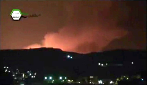 In this image taken from video obtained from the Ugarit News, which has been authenticated based on its contents and other AP reporting, smoke and fire fill the the skyline over Damascus, Syria, early Sunday, May 5, 2013 after an Israeli airstrike. Israeli warplanes struck areas in and around the Syrian capital Sunday, setting off a series of explosions as they targeted a shipment of highly accurate, Iranian-made guided missiles believed to be on their way to Lebanon's Hezbollah militant group, officials and activists said. The attack, the second in three days, signaled a sharp escalation of Israel's involvement in Syria's bloody civil war. Syria's state media reported that Israeli missiles struck a military and scientific research center near the Syrian capital and caused casualties. (AP Photo/Ugarit News via AP video)