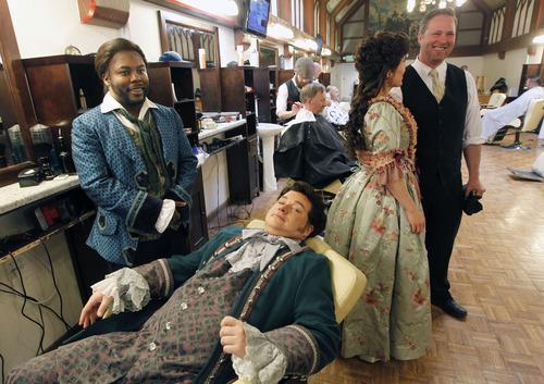 "Al Hartmann  |  The Salt Lake Tribune Utah Opera presents Rossini's comedy ""The Barber of Seville.""  Will Liverman (Figaro) , left, and Robert MacPherson (Almaviva)  re-create a scene in Ray's Barbershop around the corner from the Capitol Theatre.   Real-life licensed barber David Bean talks with opera singer Celena Shafer (Rosina), right."
