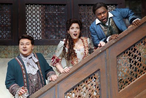 "Al Hartmann  |  The Salt Lake Tribune Utah Opera presents Rossini's comedy ""The Barber of Seville.""  Robert MacPherson (Almaviva), left, Celena Shafer (Rosina) and Will Liverman (Figaro)."