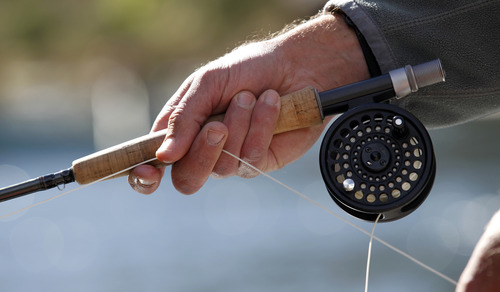 Al Hartmann     The Salt Lake Tribune  Waiting for the strike while fly fishing on the Green River below Flaming Gorge Dam.