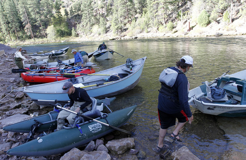 Al Hartmann     The Salt Lake Tribune  Anglers prepare at the boat ramp just below Flaming Gorge Dam for their float down the Green River.