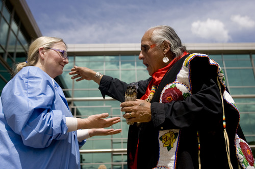"""Kim Raff     The Salt Lake Tribune (left) Janice Hood, a registered nurse, participates in a smudging ceremony by Native American shaman, Lacee Harris during the """"Blessing of the Hands"""" on the outdoor patio of the Huntsman Cancer Institute in Salt Lake City on May 6, 2013. The event gathered a diverse group of spiritual care providers to bless hospital caregivers, employees and patrons."""