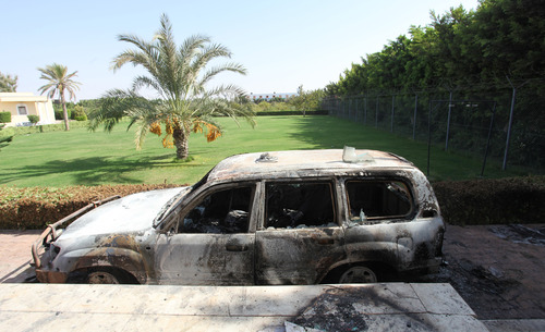 A burnt car in front of  U.S. consulate, after an attack that killed four Americans, including Ambassador Chris Stevens on the night of Tuesday, in Benghazi, Libya, Thursday, Sept. 13, 2012.  (AP Photo/Mohammad Hannon)