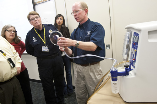 Chris Detrick  |  The Salt Lake Tribune Wayne Carlsen, Microbial-Vac Systems vice president of engineering and operations, demonstrates how to use the M-Vac System at the West Jordan Police Department Wednesday October 24, 2012.