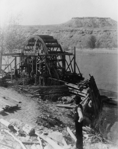 This water wheel, pictured here in the early 20th century, still stands at the Green River's Tusher diversion, which federal officials are to repair or replace this year. An ongoing environmental analysis must consider the structure's cultural values. Photo courtesy of Marriott Library, Special Collections, University of Utah.