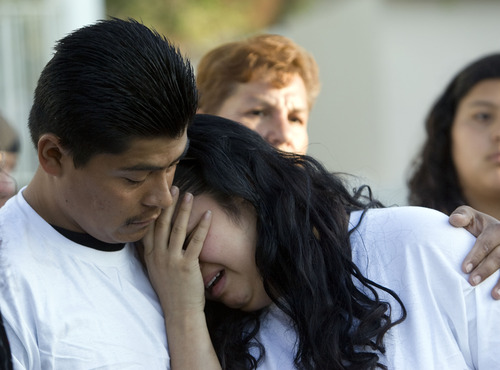 Kim Raff     The Salt Lake Tribune Johana Portillo-Lopez, daughter of soccer referee Ricardo Portillo, is comforted by Juan Munoz after speaking Sunday about her father's death during a news conference in Salt Lake City. Portillo died Saturday, a week after police say a teenage player punched him in the head during a game.