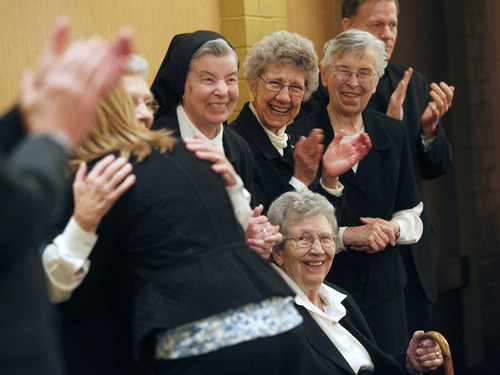 Al Hartmann  |  The Salt Lake Tribune Sisters of St. Benedict applaud the crowd gathered at the Catholic Community Services' Dream Builder's Breakfast in Ogden on Thursday. The nuns' 69 years of community service were celebrated with a Lifetime Achievers Award. The sisters will be leaving Ogden soon for a new home in Minnesota.