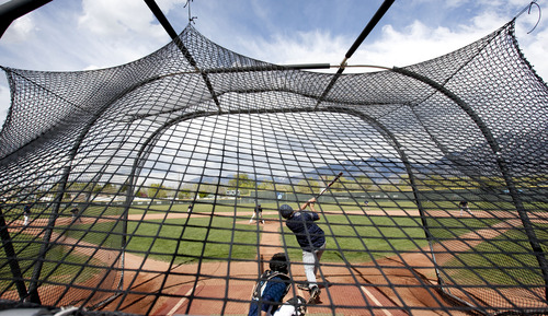 Steve Griffin | The Salt Lake Tribune   Juan Diego Catholic High School catcher, Gabe Juarez, bats during practice at the Draper, Utah high school Tuesday May 7, 2013.