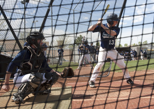 Steve Griffin | The Salt Lake Tribune   Juan Diego Catholic High School second baseman, Alex Gudac, bats during practice at the Draper, Utah high school Tuesday May 7, 2013.