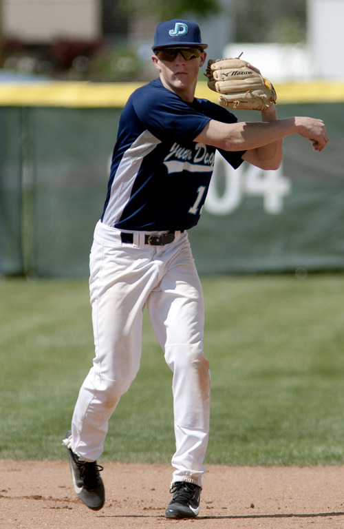 Steve Griffin | The Salt Lake Tribune   Juan Diego Catholic High School second baseman, Alex Gudac, fires to first during practice at the Draper, Utah high school Tuesday May 7, 2013.