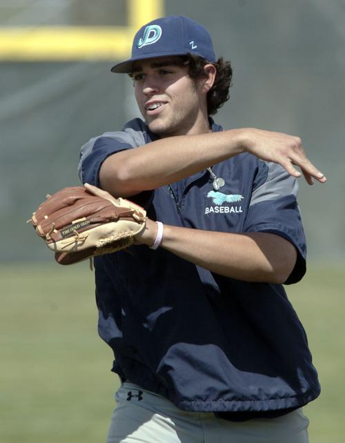 Steve Griffin | The Salt Lake Tribune   Juan Diego Catholic High School catcher, Gabe Juarez, warms-up before practice at the Draper, Utah high school Tuesday May 7, 2013.