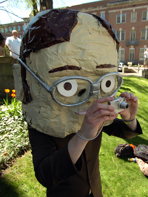 "Chris Sedlak of Dayton, Ohio wears a large bobble head mask depicting ""The Office"" character Dwight Schrute portrayed by actor Rainn Wison on Saturday, May 4, 2013 in downtown Scranton, Pa. during ""The Office"" Parade. The actors who play Pam, Jim, Dwight and other beloved characters from the popular NBC show ""The Office"" bade farewell on Saturday to the northeastern Pennsylvania city of Scranton that served as the TV setting for their fictional paper company. (AP Photo/Scranton Times & Tribune, Butch Comegys)"