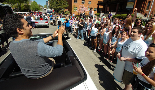 """The Office"" actor Oscar Nunez takes a picture of loyal fans during ""The Office"" Parade held in downtown Scranton, Pa. on Saturday, May 4, 2013 during ""The Office"" Parade. The actors who play Pam, Jim, Dwight and other beloved characters from the popular NBC show ""The Office"" bade farewell on Saturday to the northeastern Pennsylvania city of Scranton that served as the TV setting for their fictional paper company. (AP Photo/Scranton Times & Tribune, Butch Comegys)"