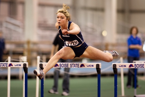 Chari Hawkins competes in hurdles at a meet. Hawkins is currently the No. 15 ranked heptathlete in the nation, and recently set Utah State's program record in the event.  Photo by Stanley Brewster
