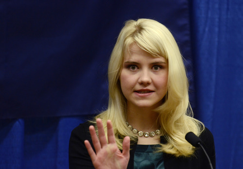 FILE - This is a Tuesday, Oct. 30, 2012 file photo of  Elizabeth Smart as she speaks to reporters regarding her advocacy of child protection and the healing process she has experienced, prior to her presentation at the Child Sexual Abuse Conference, in State College, Pa. Smart was abducted in 2002 and held prisoner for nine months before being reunited with her family.  At age 14, Smart was snatched from her bedroom in Salt Lake City, Utah in June 2002 by Brian David Mitchell, who did odd jobs for the family. Tormented over nine months by Mitchell and his wife, Wanda Barzee, Smart was freed after she was recognized in March 2003 while in public with Mitchell and Barzee. He is serving a life sentence and Barzee 16 years in prison.  (AP Photo/Ralph Wilson, File)