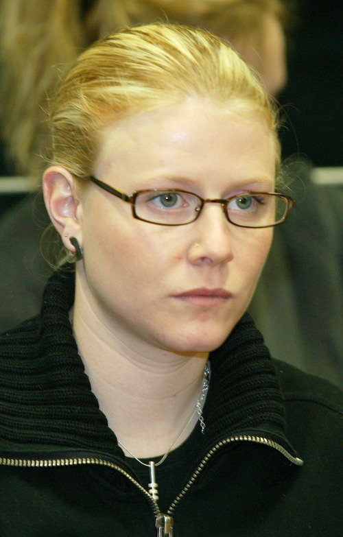 FILE - This is a Wednesday March 10, 2004 file photo of  Laetitia Delhez as she attends the hearing at the Palace of Justice in Arlon, Belgium, Wednesday March 10, 2004. Laetitia, one of two victims who survived abduction and rape at the hands of Belgium pedophile Marc Dutroux attended court Wednesday for the first time since the Belgian alleged child killer's trial began last week. Aged between 8 and 19 when snatched between mid-1995 and August 1996, the six victims were abducted, tortured and abused by Marc Dutroux. Only Dardenne, 12, and Delhez, 14, escaped alive after being found near the southern Belgian town of Charleroi a few days after Dutroux's arrest in August 1996. He is serving a life sentence. His wife, Michelle Martin, is now in a convent after serving 16 years of a 30-year prison term.   (AP Photo/Jean-Michel Clajot, Pool, File)