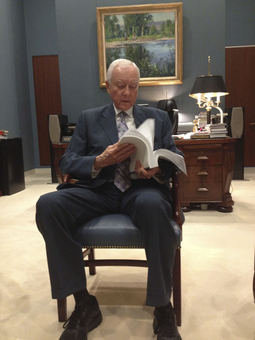 "Matt Canham | Tribune file photo Sen. Orrin Hatch flips through the 844-page immigration reform bill in his Senate Office. He said fixing the immigration problem is ""crucial."""
