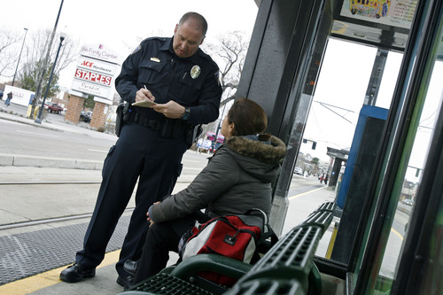 Francisco Kjolseth  |  Tribune file photo     Utah Transit Authority officer Lloyd Davis writes a citation for a woman without a boarding pass.Transit police do much more than just check tickets, also providing law enforcement and helping passengers navigate the system. UTA is undergoing a review of the police department and whether contracting or other alternatives would save money without diminishing service.