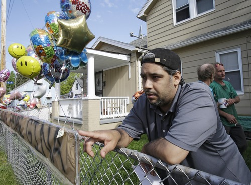 Ricardo DeJesus talks about his sister Gina at the family home Tuesday, May 7, 2013, in Cleveland. Police said Gina DeJesus and two other women who went missing separately about a decade ago were found in a house near downtown Cleveland Monday and likely had been tied up during years of captivity. Three brothers have been arrested. (AP Photo/Tony Dejak)