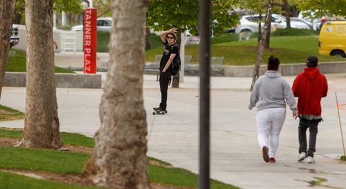 Trent Nelson  |  The Salt Lake Tribune A skateboarder glides through the University of Utah campus in Salt Lake City, Tuesday May 7, 2013. The university is considering a ban on skateboarding.