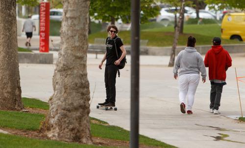 Trent Nelson     The Salt Lake Tribune A skateboarder glides through the University of Utah campus in Salt Lake City, Tuesday May 7, 2013. The university is considering a ban on skateboarding.