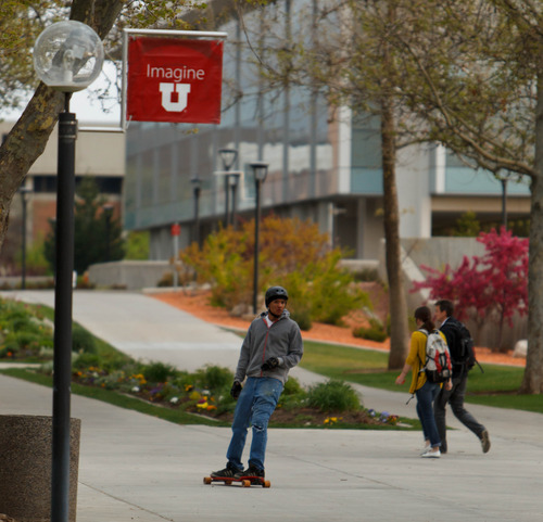 Trent Nelson  |  The Salt Lake Tribune A skateboarder rides through the University of Utah campus in Salt Lake City, Tuesday May 7, 2013. The university is considering a ban on skateboarding.
