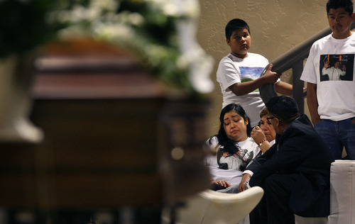 Scott Sommerdorf   |  The Salt Lake Tribune With her father's casket in the foreground, friends and family surround Johana Portillo-Lopez, center, the daughter of Ricardo Portillo, the soccer ref who died after being punched during a soccer match, at the public viewing/memorial for Ricardo Portillo, Wednesday, May 8, 2013. Second from left is Bertha Portillo, the sister of Ricardo Portillo.