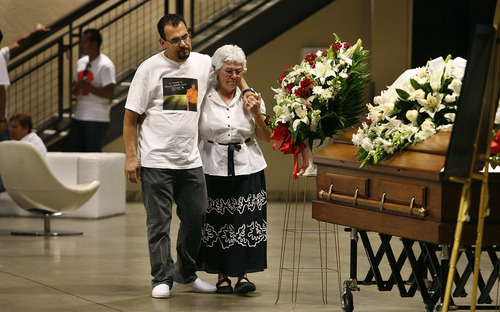 Scott Sommerdorf   |  The Salt Lake Tribune Co-workers Marco Martinez and Beatrice Manzanares visit the casket of their friend, Ricardo Portillo, the soccer ref who died after being punched during a soccer match. The public viewing/memorial for Ricardo Portillo, Wednesday, May 8, 2013.