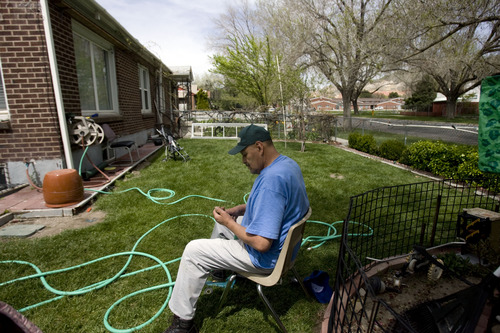 Kim Raff  |  The Salt Lake Tribune Jorge Miranda fixes a hose in the front yard of his home in the Rose Park neighborhood in Salt Lake City on April 29, 2013.