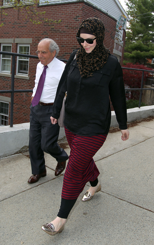 FILE - In this April 29, 2013 file photo, Katherine Russell, widow of Boston Marathon bomber suspect Tamerlan Tsarnaev, right, leaves the law office of DeLuca and Weizenbaum with Amato DeLuca, in Providence, R.I. Russell has hired New York lawyer Joshua Dratel, a criminal lawyer with experience defending terrorism cases, as she continues to face questions from federal authorities, her attorney Amato DeLuca said Wednesday. (AP Photo/Stew Milne, File)