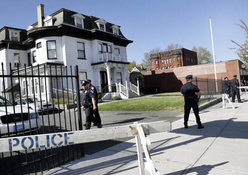 Police keep watch outside Graham, Putnam, and Mahoney Funeral Parlors in Worcester, Mass., Monday, May 6, 2013, where the body of killed Boston Marathon bombing suspect Tamerlan Tsarnaev is being prepared for burial. Funeral director Peter Stefan has pleaded for government officials to use their influence to convince a cemetery to bury Tsarnaev, but so far no state or federal authorities have stepped forward. (AP Photo/Elise Amendola)