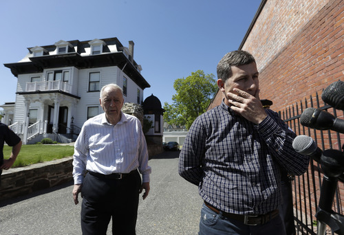 Ruslan Tsarni, right, uncle of killed Boston Marathon bombing suspect Tamerlan Tsarnaev, prepares to speak with reporters in front of the Graham, Putnam, and Mahoney Funeral Parlors, in Worcester, Mass., as funeral director and owner Peter Stefan, left, stands nearby, Sunday, May 5, 2013. Stefan has pleaded for government officials to use their influence to convince a cemetery to bury Tsarnaev, but so far no state or federal authorities have stepped forward. (AP Photo/Steven Senne)