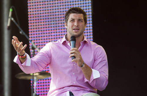 New York Jets quarterback Tim Tebow speaks during Celebration Church's Easter service in Georgetown, Texas, Sunday, April 8, 2012. (AP Photo/William Philpott)