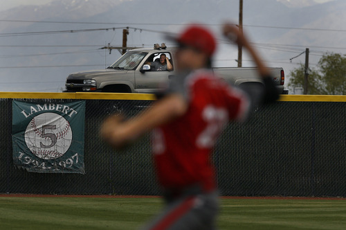 Scott Sommerdorf   |  The Salt Lake Tribune This frugal baseball fan watched the 2A matchup between Kanab and Grand County from his pickup truck parked on a hill beyond the left field fence. Kanab defeated Grand County 5-4 in it's 2A baseball playoff game played at Kearns High, Thursday, May 9, 2013. They advance to tomorrow's 2A semi-final.