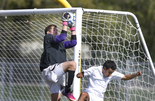 Scott Sommerdorf   |  The Salt Lake Tribune Park City goaltender Connor Dawson makes a save during first half play. Park City defeated Desert Hills 2-1 in the 3A boys' soccer state semifinal, Friday, May 10, 2013. They advance to tomorrow's 3A final.