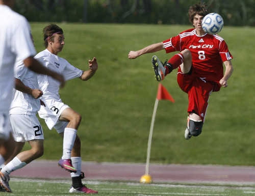 Scott Sommerdorf   |  The Salt Lake Tribune Park City's Sully Tesch makes a play on the ball as Desert Hills' Spencer Rhoton, #3, left, chases. Park City defeated Desert Hills 2-1 in the 3A boys' soccer state semifinal, Friday, May 10, 2013. They advance to tomorrow's 3A final.