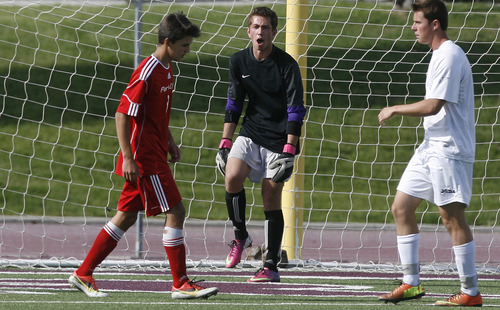 Scott Sommerdorf   |  The Salt Lake Tribune Park City goalkeeper Connor Dawson yells encouragement to his defense as they ready for a corner kick. Park City defeated Desert Hills 2-1 in the 3A boys' soccer state semifinal, Friday, May 10, 2013. They advance to tomorrow's 3A final.