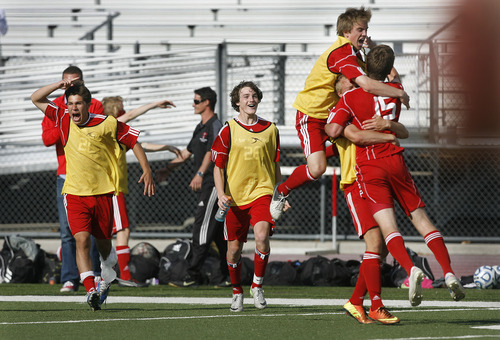 Scott Sommerdorf   |  The Salt Lake Tribune Park City celebrates after they defeated Desert Hills 2-1 in the 3A boys' soccer state semifinal, Friday, May 10, 2013. They advance to tomorrow's 3A final.