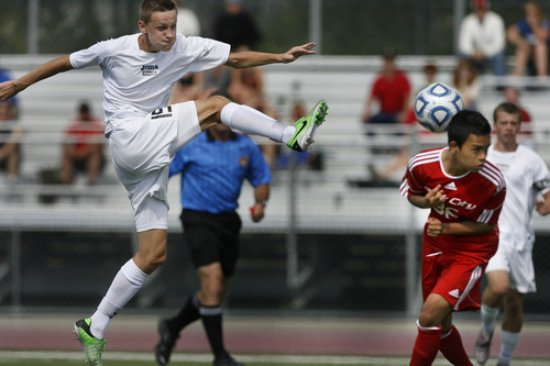 Scott Sommerdorf   |  The Salt Lake Tribune Desert Hills' Blake Evans kicks past Park City's Salvador Ramirez during second half play. Park City defeated Desert Hills 2-1 in the 3A boys' soccer state semifinal, Friday, May 10, 2013. They advance to tomorrow's 3A final.