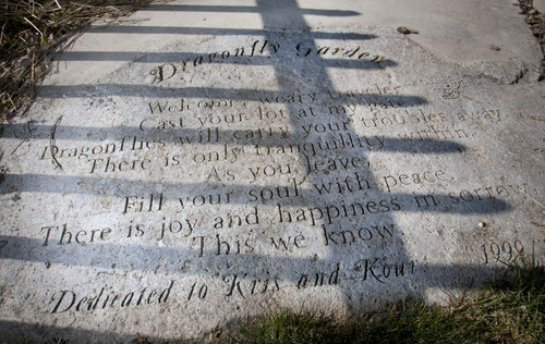 Steve Griffin  |  The Salt Lake Tribune A pathway in Ken and Lyn McGuire's dragonfly garden in their Draper backyard Thursday, May 2, 2013.  The couple started a support group, now affiliated with the LDS Church, for people who've lost family members to suicide. They lost one son to suicide and another in an accident. This large stone bears the following poem by Lyn McGuire: Welcome, weary traveler. Cast your lot at my gate. Dragonflies will carry your troubles away. There is only tranquility within. As you leave, fill your soul with peace. There is joy and happiness in sorrow. This we know.