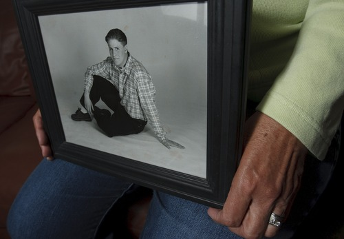 Leah Hogsten  |  The Salt Lake Tribune Lyn McGuire holds a photo of her son Kourt on Wednesday, May 1, 2013. McGuire and her husband, Ken, began an LDS Church-affiliated support group for those who've lost family members to suicide after their son Kourt took his own life.