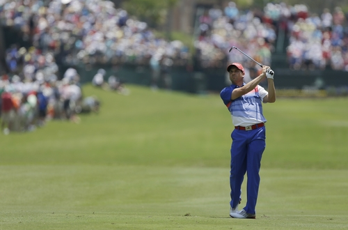 Sergio Garcia of Spain hits from the first fairway during the first round of The Players championship golf tournament at TPC Sawgrass, Thursday, May 9, 2013 in Ponte Vedra Beach, Fla. (AP Photo/John Raoux)
